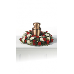 "15"" Wreath designed to display and upright urn. Larger wreaths are available upon request for an additional fee to accommodate a square or larger urn. Colors may be substituted."