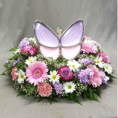 "BUTTERFLY BLESSED IS A BEAUTIFUL 15"" TABLE TOP WREATH DESIGNED TO FEATURE A STUNNING BUTTERFLY URN. THIS URN IS AVAILABLE AT GREENLAWN MORTUARIES IN BAKERSFIELD CA. WREATH AND BUTTERFLY URN ARE SOLD SEPARATELY."