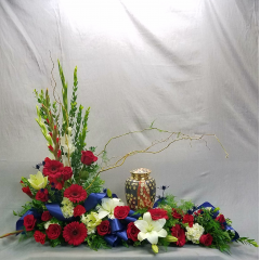 If your loved one was an American patriot this is the perfect way to honor them on last time with a large red, white and blue floral display of roses, glads, gerbera dutch daisies and other mixed flowers that compliment the urn. This stunning urn is available at Greenlawn Cemeteries in Bakersfield CA. and is sold separately from the floral display.