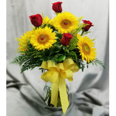 """This is a classic fun bouquet that is well received for any occasion. It stands approximately 24"""" tall and includes sunflowers and red roses. We are happy to substitute a different color rose upon request.."""