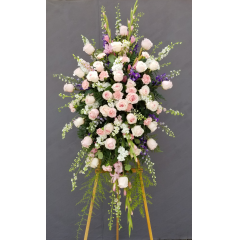 A Exquisite Easel Of Pink Roses And Carnations/Snapdraggons Or Glads For A Larger Impact,With Trailing Greens.