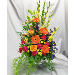 An Array Of Spring Flowers Arranged In A Machet With Trailing Ivy And Ruscus. Beautiful!