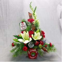 "Fun, fun, fun is what your special someone will have when you surprise them with this festive, one- sided arrangement of fresh holiday greens and seasonal flowers in red and white tones! This arrangement is approximately 23"" tall and the ceramic container; which, is a nice keepsake to be used for years to come."