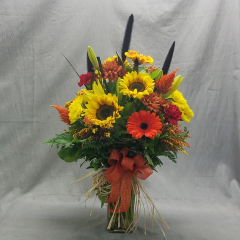 "ALL THE COLORS OF FALLARE ON FULL DISPLAY IN THIS BRIGHT VIBRANT ARRANGEMENT. IT IS DESIGNED TO BE SEEN FROM ALL SIDES AND STANDS APPROXIMATELY 30"" TALL AND 20 INCHES WIDE."
