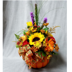 Our very own Log Cabin ceramic pumpkin filled with falls finest blossoms...a great way to welcome the season!