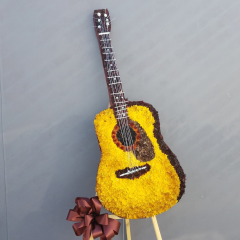 This is a one of a kind memorial tribute to the talented Acoustic Guitarist in your life. This design stand aproximately 6 ft tall to the top of the nect of the Guitar. Please call for custom details and product availability as it takes time to custom carve and flower these beautiful tributes.