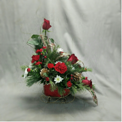 "A beautiful metal sleigh that will decorate a table for the holidays. Overall height is approximately 18"". This arrangement is designed all around to be used as a centerpiece. It is a great size for a coffee table or a dining table that seats 4 to 6 people."