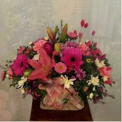 """The perfect basket arrangement for your Easter Celebration! This whimsical bouquet is filled with Easter eggs and the colors of Spring! It is approximately 16"""" tall and 24"""" long. A beautiful design for your table, buffet or coffee table!"""