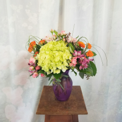 "Beautiful spring mix of hydrangeas, spray roses, and alstromeria. As shown is approx 17""H x 13""W"
