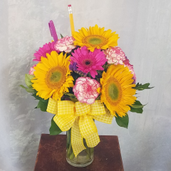 A cheery mix of Sunflowers, gerbs and carnations for a teacher's desk or office. To make it festive we included a pencil and highlighter in arrangement.