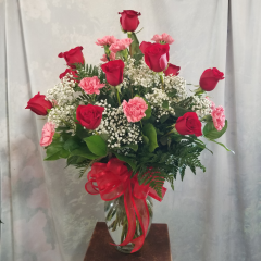 ONE DOZEN OF OUR IMPORTED RED ROSES AND ONE DOZEN ELEGANCE CARNATIONS ARRANGED IN A VASE.  IF THEY HAVE A FAVORITE COLOR OF CARNATIONS WE WOULD BE HAPPY TO CUSTOMIZE THAT FOR YOU...JUST ASK!
