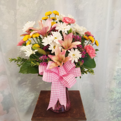 Arranged To Welcome Your New Little Bundle Of Joy, This Beautiful Bouquet Of Lilies, Carnations, Daisies And Button Mums Are Perfect! WE would be happy to adjust colors to reflect if the bouquet is for a boy or girl. Just let us know!