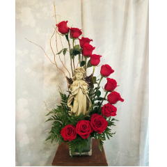 Dozen roses arranged in a unique spiral design in a cube. Comes with a beautiful keepsake angel to keep as a remembrance for loved one. **colors can vary in red, white, pink, yellow and cherry brandy**