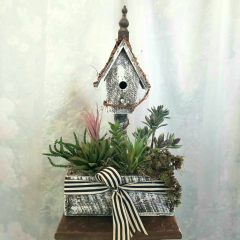 For any home or office a cute wooden Birdhouse filled with artificial succulents. Approx 21h x 13w