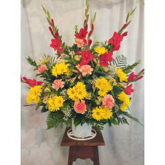"A Respectful combination Of Red Gladiolus/Yellow Daisies, Alstroemeria , Orange Carnations with Baby's Breath. Approx. 36""H x 36""W"