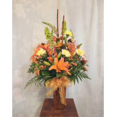 "A nice autumn arrangement filled with carnations, lilies, alstro, snaps, cattails, etc. **Flowers may vary or subject to change in fall tones** Approx. 30""H x 17""W"