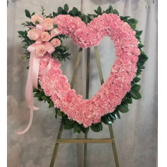 Classic open heart design featuring roses and carnations in a tasteful, elegant tribute. **Colors can vary to either: red, white, pink (as shown) or yellow**