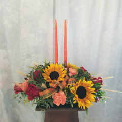 "Decorate your table with this lovely fall centerpiece, with roses, sunflowers, carnations, wheat and 2 taper candles. Approx. 18""H x 24""W"