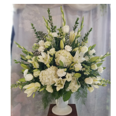 "The classic elegance of an all white floral display. Wishing you peace. Approx. 36""H x 36""W"