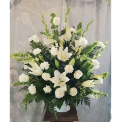 "The all white arrangement is a beautiful tribute that stands out at a visitation or a service. Approx. 36""H x 33""W"