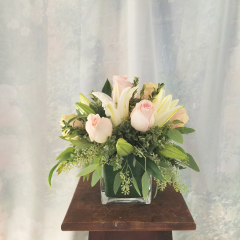 """A stylish bouquet of roses and lilies. This petite arrangement is perfect for a office desk, table for two or where space is limited. Approx. 12""""H X 12""""W"""