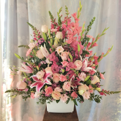 "A beautiful arrangement of all pink glads, carnations, roses and snapdragons accented with lavender lizzy and pink sweet william.  Approx. 36""H x 33""W"