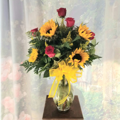 "This Classic, Fun Bouquet is always well received.  Standing approximately 24"" tall, our Ladies in the Sun arrangement is filled with Gorgeous Sunflowers and Brilliant Red Roses.  (We are happy to substitute a different color rose upon request)"