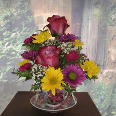 This sweet arrangement comes in its own dainty keepsake tea cup. Gathered are roses, alstromeria and mums. Who wouldn't love this adorable gift? **Tea cup design and color of flowers may vary depending upon availability**