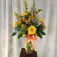 "Nice bouquet that looks like it was picked from the garden in a clear vase with fun decorative bow. Approx. 32""H x 18""W **Flowers may be subject to change due to availability**"