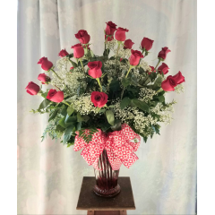 """Make a statement with this beautiful 2 Dozen red roses in a red swirl vase with a valentine's bow. Approx 33""""H x 23""""W"""
