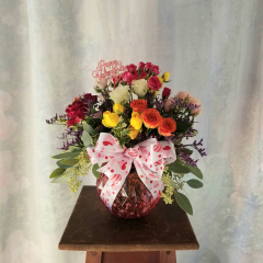 """Cute little bouquet of mixed color spray roses in a rose color bubble vase with valentine bow and pick that say's """"Happy Valentine's Day"""" Approx. 14""""H x 12""""W"""