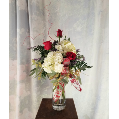"""3 Red Roses with white hydrangea in a nice clear vase, valentine treatment and ting ting. Approx 23""""H x 11""""W"""