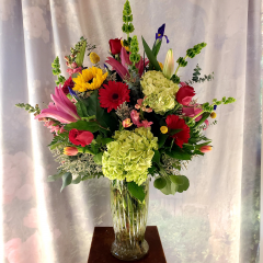 "This very large arrangement is approximately 36"" tall and 33"" wide. Everyone will turn their heads when this vibrant floral display arrives! Add Mylar balloons for an over the top presentation they will never forget!"
