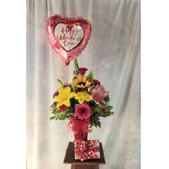 """Featuring our Valentine Gotcha Premium comes with mixed bouquet in a red vase decorated with valentine's bow, Happy Valentine's Mylar and 1/2lb See's Chocolates ***Colors of flowers may vary, also mylar may vary** Approx. 27""""H x 16""""W"""
