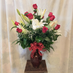 """Beautiful One dozen Red roses with 5 fragrant Stargazer lilies and valentine bow. Approx. 30""""H x 22""""W"""