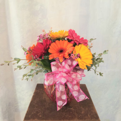 "Bright colorful mix of Gerbera Daisies with filler in a etched bubble bowl. Fun and festive for summer!! Approx 12""H x 12""W **Colors of gerbs and vase may vary**"