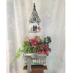 "This cute artificial succulent in a wooden Birdhouse that will last forever. Approx. 30""H x 18""W"