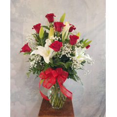 LOG CABIN FLORIST HAS BEEN VOTED BEST FLORIST IN BAKERSFIELD FOR 25 YEARS IN A ROW! TO CELEBRATE THIS AMAZING ACCOMPLISHMENT WE HAVE DESIGNED THE BEST OF BAKERSFIELD BOUQUET. A LARGE ARRANGEMENT OF A DOZEN RED ROSES AND STARGAZER LILIES IS THE PERFECT GIFT FOR THE BEST MOM IN THE WORLD TOO. LET'S CELEBRATE TOGETHER!