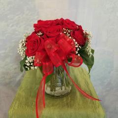 "This small arrangement is approximately 10"" tall and is the perfect size to set on a desk or  a small table centerpiece."
