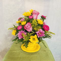 This sweet arrangement comes in a decorative tea cup. Gathered are roses, asters and mums. Who wouldn't love this adorable gift? **Tea cup color and color of flowers may vary depending upon availability**