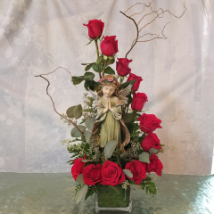 Dozen roses arranged in a unique spiral design in a cube. Comes with a beautiful keepsake angel to keep as a remembrance for loved one. **colors can vary in red, white, pink, yellow**
