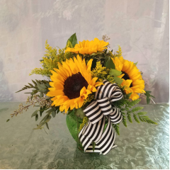 "Cute bouquet of sunflowers perfect for a desk, small space or table in a glass vase. **Container may vary** Approx 10"" tall"