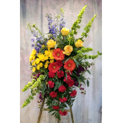 An Array Of Spring Flowers Designed On A Standing Easel, Flowers Are Grouped By Color For Maximum Impact.