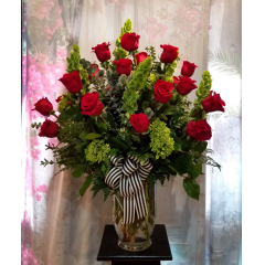 "An amazing way of  saying ""I Love You"" with 2 Dozen Roses, Bells of Ireland, Green Hydrangea, Spiral Eucalyptus and various greens in an upgraded vase and finished off with a striped bow"