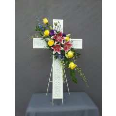 """This is a unique shabby chic metal cross that measures 44"""" tall standing on it's own easel. The cluster of mixed flowers can be customized in whatever color scheme you choose. This is a design that the family may take home and keep as a keepsake to be displayed in their garden or to hang on a wall."""