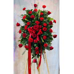 A Bold Statement In All Red Roses And Carnations.