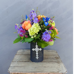 "A beautiful way to say ""Happy Mother's Day"" A nice mixed bouquet with hydrangea, iris, roses, stock and filler in a purple frosted diamond cut vase with metal jeweled cross to adorn the vase. Approx 16""H x 13""W ***flowers may be subject to change due to availability***"