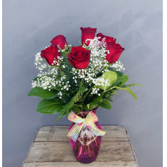 "A half dozen or our premium long stem roses arranged with million star in a pink glass vase with a bow tied on the neck. Roses are always special and always create a heartfelt memory. Say thanks Mom, you are the best today!  **Approx 20""H**"