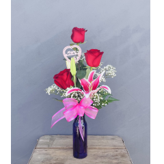 "A sweet bouquet for Mom with 3 red roses and 1 oriental lily in a purple vase. **Approx 21"" H**"