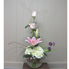 DiBella Flowers & Gifts Las Vegas - Simple Elegance A gorgeous design perfect for a dining table, wedding or front desk. Light pink roses, stargazer lilies, hydrangea and tulips swirl a clear bubble bow.